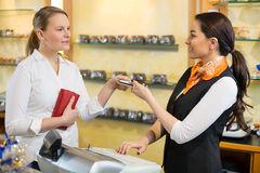 client-shop-paying-cash-register-saleswoman-37913348